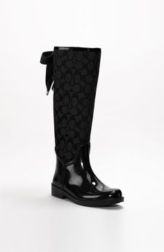 I believe this rain boot is Coach and it has a bow.  I think we have a winner, people.