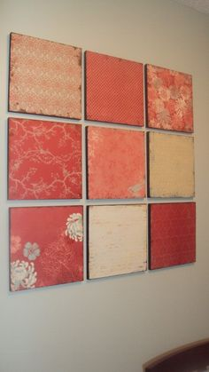 Scrapbook pages on wood for art on the walls.