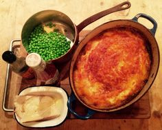 "Cottage pie. ( carrots, onion, star anise, thyme, evoo, beef mince ""blowtorched"", reduced chicken stock, veal stock, red wine, flour, Worcestershire sauce, tomato purée. Mash of King Edwards with milk & butter. Cheddar cheese top with smoked paprika). Served with bread n butter, peas, ketchup & Worcestershire sauce."
