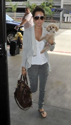 Ashley Tisdale has the world's cutest hand luggage. ;)