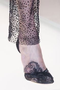 Idea: covering a un with overlapping lace that climbs uo the foot just a hint: Armani Privé at Couture Fall 2013 - StyleBistro