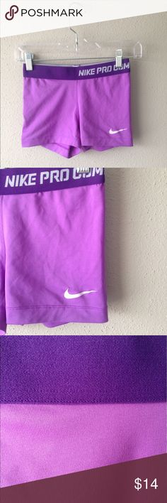 Purple Multi Nike Pros SZ small Cute Nike pros, I never wore them but the Nike symbol is cracked for some reason. See the last photo. As you can see from the pictures, though, the condition is excellent! Nike Shorts