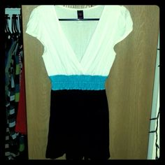 Empire Waist Top Super soft material with some light pulling all over. Plenty of wear left in this top. The top is an off white color. Wrapper Tops
