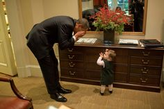 "we have the cutest president ever. ""President Barack Obama plays peek-a-boo with Maeve Beliveau, the daughter of Director of Advance Emmett Beliveau, in the Outer Oval Office, Oct. 30, 2009. (Official White House Photo by Pete Souza)"""