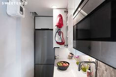 The new kitchen layout in Karen and Kevin's Upper East Side apartment brought the opportunity to eke out more storage in every possible place—which meant custom cutting larger IKEA cabinets to fit the space.