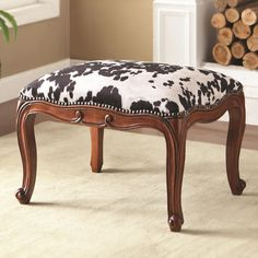 White and black cow hide print fabric upholstered ottoman with espresso finish wood Ottoman, Furniture, Modern House Design, Modern House, Eclectic Interior, Log Cabin Decor, Cowhide, Cowhide Ottoman, Wood Finish