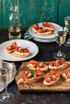 tomato and basil crostini with whipped goats cheese @DrizzleandDip