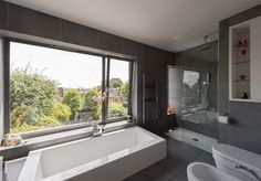 En-suite, bath by window close-up (Hornsey Lane, London N6 — The Modern House Estate Agents: Architect-Designed Property For Sale in London and the UK)