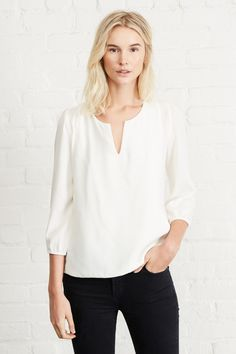 FREE SHIPPING - FREE RETURNS Blythe is your classic silk white blouse with a…
