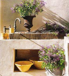 Veranda Magazine, stone garden sink
