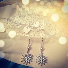 Double drop starburst earrings; Crystal pavé starburst earrings suspended from white pearls! Perfect #wedding look!