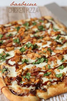 Delicious Barbecue Chicken Pizza recipe { lilluna.com } Homemade pizza dough topped with mozzarella, chicken, bacon, cilantro, and BBQ sauce.