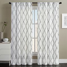 Dress your window in chic style with the Dixon Embroidered Sheer Grommet Top Window Curtain Panel Pair by VCNY home. Embellished with Moroccan-inspired embroidery, the sheer panels add an ornate touch to any room's décor.