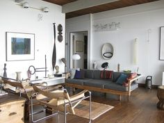 wall work is cool #livingroom  interior design, sofas, flooring, ceiling, lighting, rugs, coffee tables, art in the living room #decorating loft wa…