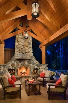 Nothing draws a party outside quite like a warm, toasty fire. In this Washington home, a full-size fireplace made from local glacial stone creates a gathering spot and instant focal point in the outdoor area. Photo by Roger Wade.