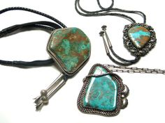 Two Navajo bolo ties and a pendant