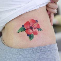 Red hibiscus flower tattoo on the hip. Hawaiian Tattoo Meanings, Hawaiian Flower Tattoos, Hibiscus Flower Tattoos, Hawaiian Tribal Tattoos, Samoan Tribal, Filipino Tribal, Hibiscus Flowers, Hawaiian Flowers, Tattoos For Women Flowers