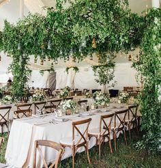 Draped tented wedding reception,greenery chandelier,greenery wedding decorations
