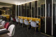Mirrored Wall - Dark Interior - Dining Chairs - Paris Restaurant - Hospitality Design - Glam Style