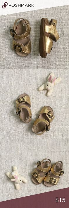 🆕EUC: Toddler Girls 5 Gold Metallic Sandals 🌅🌅 German made Birkenstock style sandals with metallic gold pebbled leather upper, suede covered cork footbed, and natural rubber sole and brass buckles.  Adorable!  Show minimal signs of wear. Shoes Sandals & Flip Flops