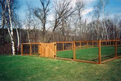 dog fence with an elevated covered shelter on North End to block winter wind