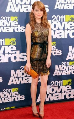 Emma is fierce in a Bottega Veneta sheer dress. I love the color combo of yellow and red