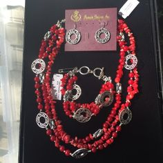 Premier Designs Firecracker 3 piece set Necklace, bracelet and earrings all that match! Beautiful red coral like beads with silver accents to dress up your LBD!  Necklace is adjustable between 17-20 inches. Lifetime warranty with Premier designs (excluding normal wear and tear) Premier Designs Jewelry