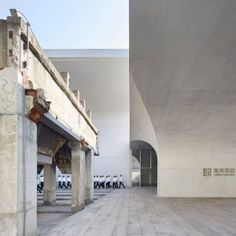 Shanghai art museum by Atelier Deshaus brings together vaulted columns and an industrial relic