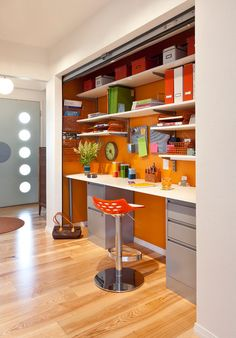 midcentury home office by Kropat Interior Design; roll up metal door hides area when not in use.  Clever!