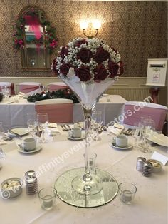Martini vase centrepiece with red roses and gypsophila.  Wedding hire in Swansea, South Wales
