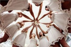 """A """"from below"""" shot of the bridesmaids' toast. 