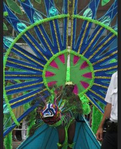 Amazing feathered costume at West Indian  America Labor Day Parade down Eastern Parkway. Image © E. Freudenheim 2013
