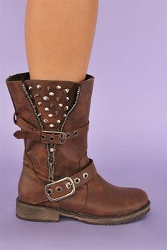 The Guns N Roses Rocker Boots are so sick! These boots are so rocker chic! They feature a short boot look, with faux leather throughout. They have straps around the front and back, with faux zipper on the side, with spike/stud embellishment on each side. These boots will be perfect for all your rocker needs this winter! See our other color!