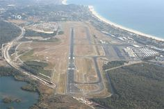 Gold Coast Airport's main runway ,492m x 45m and lies within a 2,552 x 150m runway strip. See similar images @ http://www.airport-technology.com/projects/goldcoastairport/