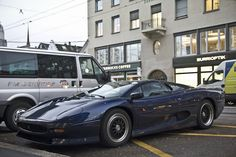 And here is a Jaguar XJ220 in a beautiful shade of midnight blue.