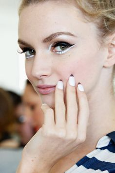 The contrast between the white and black eyeliner is so eye-catching (literally!). Kate Spade Spring 2014