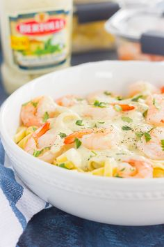 This Grilled Shrimp Alfredo Pasta is packed with tender noodles and grilled shrimp, all tossed in a creamy basil alfredo sauce. Simple to make and ready in less than 30 minutes, this easy meal will keep you going on busy weeknights!