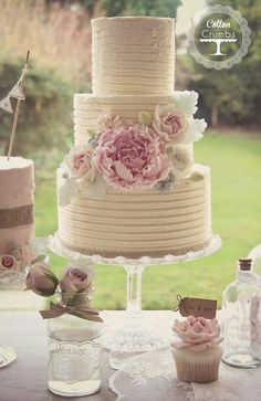 Cotton & Crumbs. Naked cake buttercream pink blue flowers peony roses berries.