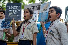 Children shout slogans as they participate in a climate strike, September 20, 2019.  Photo credit: Laurène Becquart / AFP — at New Delhi.