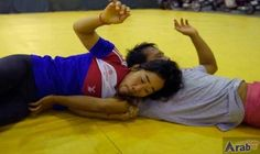 Women wrestle with Cambodia's sporting taboo