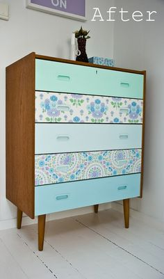 vintage dresser become quite lovely... I think I'd rather decoupage w fabric than dabble in wallpaper, though.