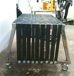 I made this (with my team)! Welded steel bench with bike tire inner tube weaving on locking castors.