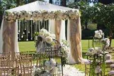 OOO!!! Decorate a small tent and use as your ceremony arch...