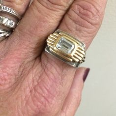 "Feinberg""gold/silver Two Tone Ring vintage 🎉sale SALE!! Genuine 14k gold 925 silver thick heavy"" Designer jay feinberg two tone zircon diamond radiant cut ring .925 14jjar top"" hallmarked inner band can be unisex size 9 or a great gift for the hot man in your life Nice statement ring. Jay feinberg is listed designer he now uses his mothers maiden name his on some later & most recent pieces Thick solid gold & silver    Top designer marked ring the yurman of yesterday. Feinberg Jewelry Rings"