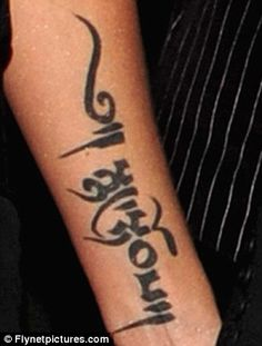 Collection: Harding also has a star under her ear and a Tibetan script which means 'inner strength' on her left forearm