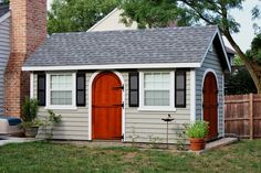 Garden Shed with lap siding and rounded wood doors http://www.backyardunlimited.com/sheds/garden-sheds