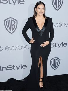 Flashing some leg: Pregnant Eva Longoria sported a plunging tuxedo-esque dress with split ...