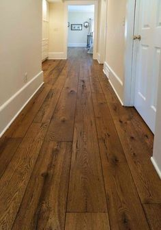 Hardwood flooring pro: engineered hardwood flooring features several thin layers of wood that have been glued together and laminated, then treated with high heat. It can be installed anywhere, even in areas with high moisture like the bathrooms, kitchens and basements. #laminatewoodflooring