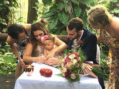 Baby signing the certificate awww Suzanne Riley Marriage Celebrant on the Sunshine Coast