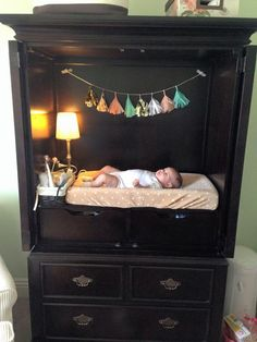 TV Armoire Refurbished into a Changing Table with Storage - How Cute!